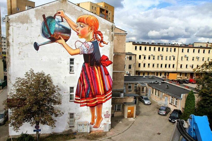 girl watering plant mural